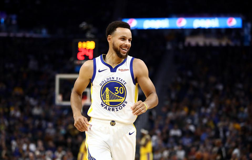 Stephen Curry smiles during a Warriors Game