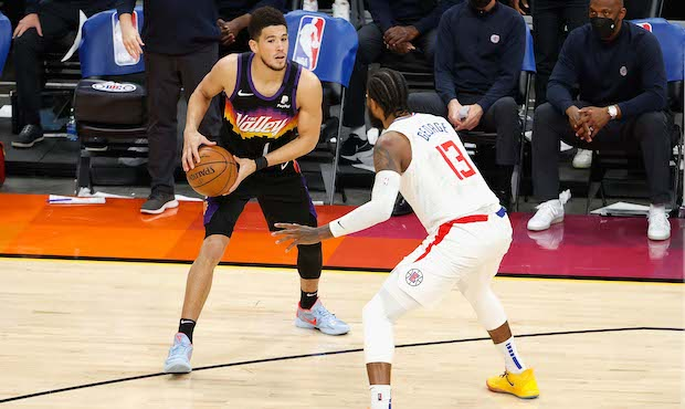 Devin Booker is guarded by Paul George in Los Angeles Clippers Vs Phoenix Suns.